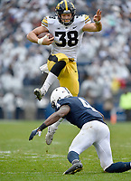 STATE COLLEGE, PA - OCTOBER 27: Iowa TE T.J. Hockenson (38) hurdles Penn State S Nick Scott (4) after a catch. The Penn State Nittany Lions defeated the Iowa Hawkeyes 30-24 on October 27, 2018 at Beaver Stadium in State College, PA. (Photo by Randy Litzinger/Icon Sportswire)