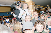 People watch as Democratic presidential candidate Pete Buttigieg arrives to speak at a campaign event at Gibson's Bookstore in Concord, New Hampshire, USA, on Sat., Apr. 6, 2019. Buttigieg is the mayor of South Bend, Indiana, and was widely considered a long-shot candidate until his appearance in a CNN town hall in March 2019 which catapulted his campaign to prominence and substantial donations.