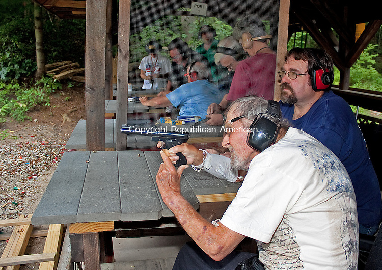 NAUGATUCK, CT.-18 AUGUST 2011-081811DA06-  Daniel Crook of the VA hospital in West Haven takes a shot of a target with the guidance of Michael Nolan a member of  the High Rock Shooting Club in Naugatuck on Thursday. Members of the club invited 17 veterans from the VA hospital to a day of recreational shooting followed by lunch.<br /> Darlene Douty Republican American