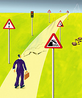 Businessman standing on dangerous cracking road ExclusiveImage