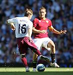 West Ham's Mark Noble goes past Roma's Francesco Totti. .Pic SPORTIMAGE/David Klein