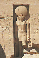 The sun god, Re, is usually shown, as in this figure at the Temple of Ramses II in  Abu Simbel, with a falcon's head and with the disk of the sun above that head. This figure, though large, is dwarfed by the four massive colossi of Ramses II at Abu Simbel.