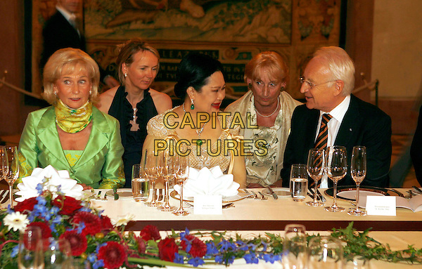 KARIN STOIBER, QUEEN SIRIKIT & EDMUND STOIBER.Queen Skirit of Thailand visits Munich, Bavaria, Germany..July 19th, 2007.half length black green silk satin cream royalty dress table sitting.CAP/PPG/TF.©People Picture/Capital Pictures *** Local Caption *** 00326011