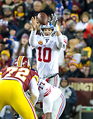 New York Giants quarterback Eli Manning (10) fields a high snap in the first quarter against the Washington Redskins at FedEx Field in Landover, Maryland on Thursday, November 23, 2017.<br /> Credit: Ron Sachs / CNP<br /> (RESTRICTION: NO New York or New Jersey Newspapers or newspapers within a 75 mile radius of New York City)
