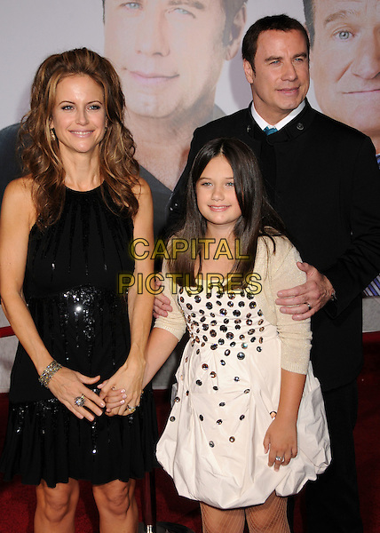 """KELLY PRESTON, ELLA BLEU TRAVOLTA & JOHN TRAVOLTA .""""Old Dogs"""" Los Angeles Premiere held at the El Capitan Theatre, Hollywood, California, USA, 9th November 2009..half length mother daughter father dad mum mom married couple husband wife family  sleeveless black dress sequined sequin collarless jacket trousers cream beige gold holding hands.CAP/ADM/BP.©Byron Purvis/AdMedia/Capital Pictures."""