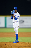 Burlington Royals relief pitcher Luis Alcantara (57) looks to his catcher for the sign against the Danville Braves at Burlington Athletic Stadium on August 14, 2017 in Burlington, North Carolina.  The Royals defeated the Braves 9-8 in 10 innings.  (Brian Westerholt/Four Seam Images)