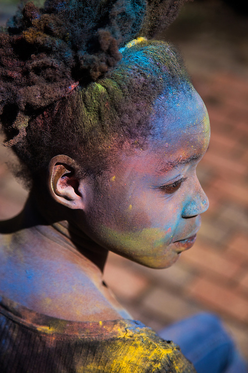 Tshepi Mogwera takes on the color of the rainbow during the Holi Festival of Color on Saturday March 15, 2014 at Ohio University. Photo by Ohio University / Jonathan Adams