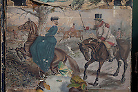 Detail of two riders on a Victorian decoupage screen