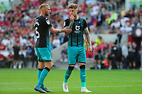 (L-R) Mike van der Hoorn speaks with Joe Rodon of Swansea City during the Sky Bet Championship match between Bristol City and Swansea City at Ashton Gate in Bristol, England, UK. Saturday 21 September 2019