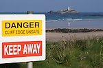 Danger, warning signs along the cliff edges at Godrevy, Cornwall, UK