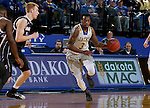 BROOKINGS, SD - JANUARY 7:  Chris Howell #3 from South Dakota State University looks pushes the ball past Mitch Hahn #44 from the University of Nebraska Omaha during their game Saturday afternoon at Frost Arena in Brookings. (Dave Eggen/Inertia)