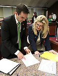 Nevada Assembly Republicans Derek Armstrong and Michele Fiore work on the Assembly floor at the Legislative Building in Carson City, Nev., on Tuesday, March 17, 2015. <br /> Photo by Cathleen Allison