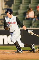 Ian Gac #33 of the Kannapolis Intimidators follows through on his swing against the Rome Braves at Fieldcrest Cannon Stadium April 11, 2010, in Kannapolis, North Carolina.  Photo by Brian Westerholt / Four Seam Images