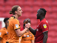 8th July 2020; Ashton Gate Stadium, Bristol, England; English Football League Championship Football, Bristol City versus Hull City; Tom Eaves of Hull City and Famara Diedhiou of Bristol City bump hands after the match