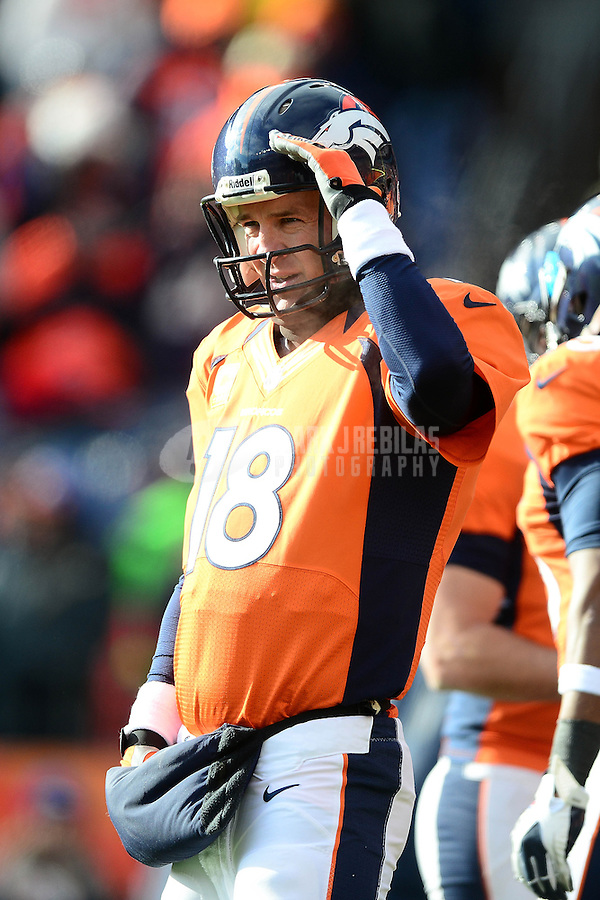 Jan 12, 2013; Denver, CO, USA; Denver Broncos quarterback Peyton Manning (18) prior to the game against the Baltimore Ravens during the AFC divisional round playoff game at Sports Authority Field.  Mandatory Credit: Mark J. Rebilas-