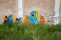 """Let me paint Mopac!"" is a beloved graffiti painting on the side of the overpass at RM 2222 and Mopac north Austin, Texas by a new and mysterious graffiti artist know as Drib - Stock Image."