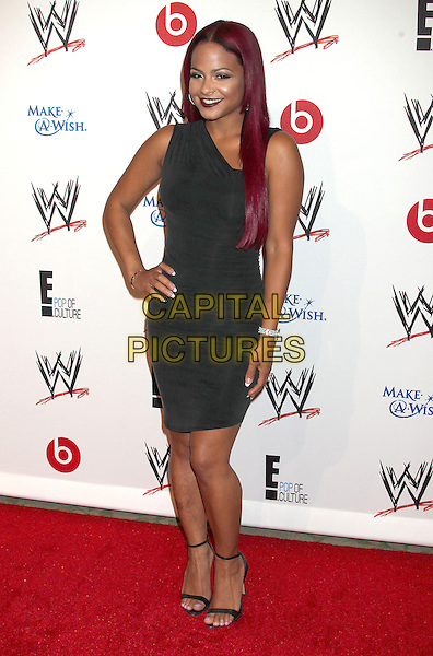 Christina Milian<br /> WWE &amp; E! Entertainment's &quot;SuperStars For Hope&quot; supporting Make-A-Wish at The Beverly Hills Hotel in Beverly Hills, CA., USA.<br /> August 15th, 2013<br /> full length dress black one shoulder hand on hip<br /> CAP/ADM/RE<br /> &copy;Russ Elliot/AdMedia/Capital Pictures