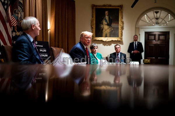 United States President Donald J. Trump makes remarks as he attends a meeting with Governor Asa Hutchinson (Republican of Arkansas), left, and Governor Laura Kelly (Democrat of Kansas) in the Cabinet Room of the White House in Washington, DC,  Wednesday, May 20, 2020.   <br /> Credit: Doug Mills / Pool via CNP/AdMedia