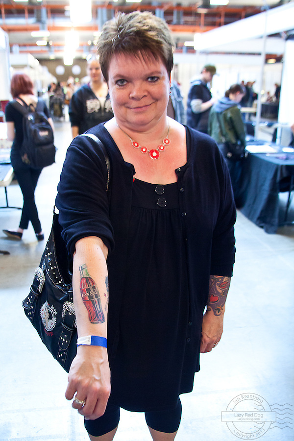 Copenhagen Inkfestival 2012. Tattoo of a Coca Cola bottle on arm