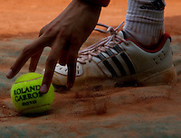 A ball boy picks up a ball during the Safina against Date Krumm match..Tennis - French Open - Day 3 - Tue 25 May 2010 - Roland Garros - Paris - France..© FREY - AMN Images, 1st Floor, Barry House, 20-22 Worple Road, London. SW19 4DH - Tel: +44 (0) 208 947 0117 - contact@advantagemedianet.com - www.photoshelter.com/c/amnimages