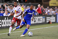 Teal Bunbury (blue), Roy Miller..Kansas City Wizards were defeated 3-0 by New York Red Bulls at Community America Ballpark, Kansas City, Kansas.