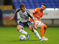 Bolton Wanderers' Dennis Politic under pressure from Blackpool's James Husband<br /> <br /> Photographer Kevin Barnes/CameraSport<br /> <br /> The EFL Sky Bet League One - Bolton Wanderers v Blackpool - Monday 7th October 2019 - University of Bolton Stadium - Bolton<br /> <br /> World Copyright © 2019 CameraSport. All rights reserved. 43 Linden Ave. Countesthorpe. Leicester. England. LE8 5PG - Tel: +44 (0) 116 277 4147 - admin@camerasport.com - www.camerasport.com