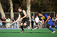 NZ's Simon Childs prepares to shoot at goal under pressure from Muhammad Amin Rahim during the international hockey match between the New Zealand Black Sticks and Malaysia at Fitzherbert Park, Palmerston North, New Zealand on Sunday, 9 August 2009. Photo: Dave Lintott / lintottphoto.co.nz