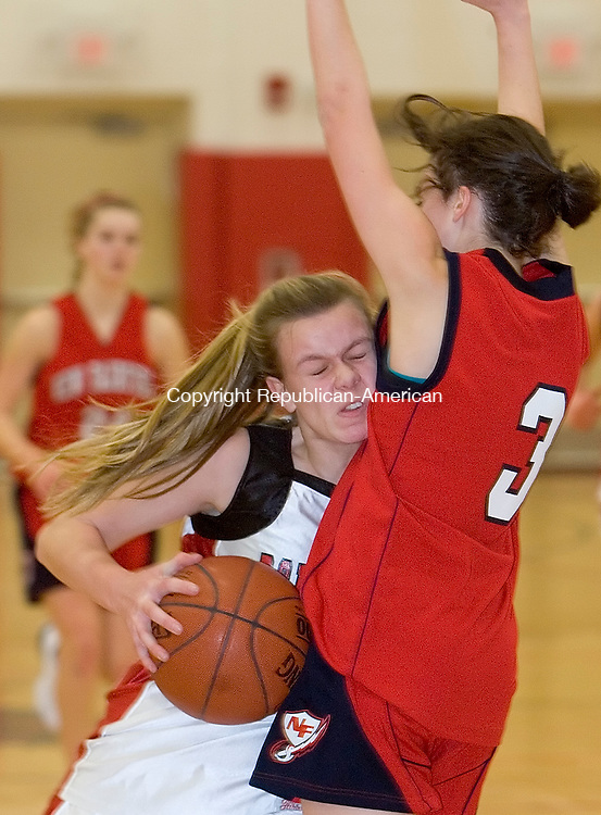 SOUTHBURY, CT- 21 JANUARY 2009 --012709JS13-Pomperaug's Kasey Dean (33) draws a foul on New Fairfield's Liz LaRegina (3) while driving to the basket during their game Tuesday at Pomperaug HIgh School in Southbury. <br /> Jim Shannon / Republican-American