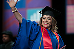Students receive their degrees from Marisa Alicea, dean of the School for New Learning, Saturday, June 10, 2017, during the DePaul University School for New Learning commencement ceremony at the Rosemont Theatre in Rosemont, IL. (DePaul University/Jeff Carrion)