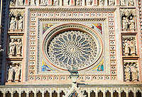 The Gothic rose window built by the sculptor and architect Orcagna between 1354 and 1380 on the14th century Tuscan Gothic style facade of the Cathedral of Orvieto, designed by Maitani, Umbria, Italy