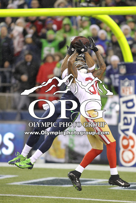 Dec 23, 2012:  Seattle Seahawk's Doug Baldwin and San Francisco 49ers Donte Whitner go up for a pass during Sunday nights game of the week at Century Link Stadium in Seattle WA.  Seattle defeated San Francisco 42-13.