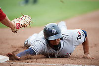 San Antonio Missions shortstop Jose Rondon (13) dives back to first base during a game against the Springfield Cardinals on June 4, 2017 at Hammons Field in Springfield, Missouri.  San Antonio defeated Springfield 6-1.  (Mike Janes/Four Seam Images)