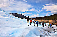 Trekking on the blue ice of Glacier Perito Moreno in Parque Nacionales los Glaciares, Argentina.