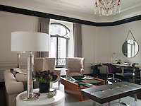 The Bentley Suite living room is decorated with ivory coloured walls accented with a crisp black moulding