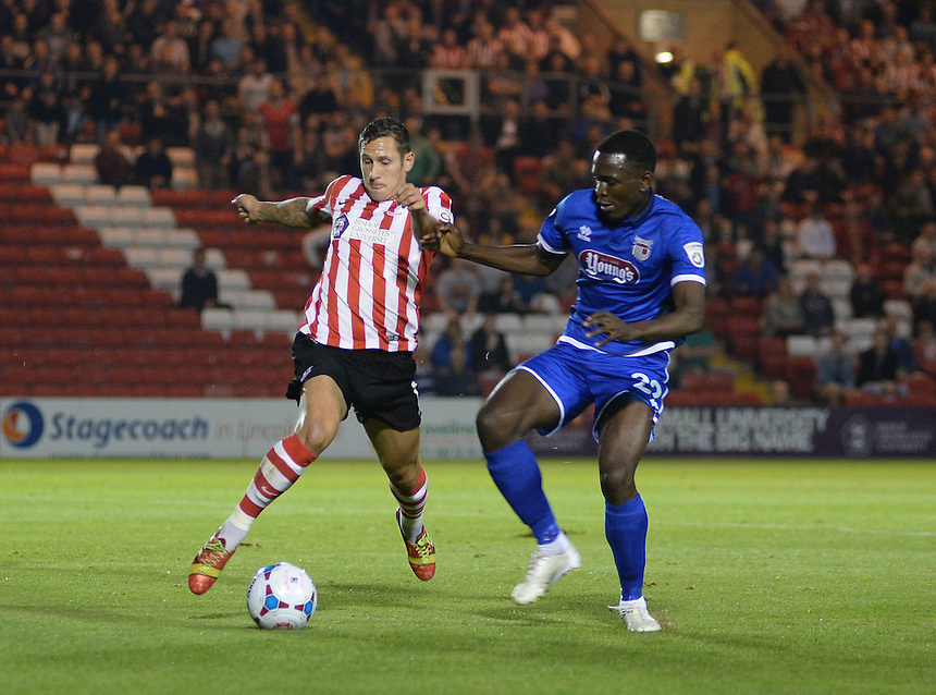 Lincoln City's Ben Tomlinson is fouled by Grimsby Town's Aristote Nsiala to win his first penalty of the game<br /> <br /> Photo by Chris Vaughan/CameraSport<br /> <br /> Football - English Football Vanarama Conference Premier League - Lincoln City v Grimsby Town - Tuesdayb9th September 2014 - Sincil Bank - Lincoln<br /> <br /> &copy; CameraSport - 43 Linden Ave. Countesthorpe. Leicester. England. LE8 5PG - Tel: +44 (0) 116 277 4147 - admin@camerasport.com - www.camerasport.com