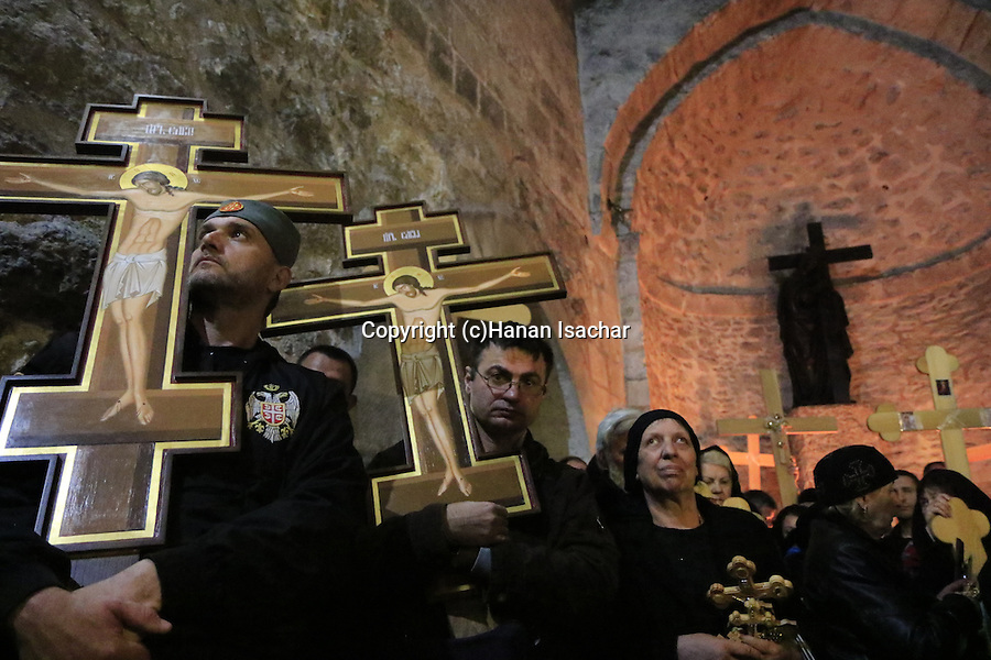 Israel, Jerusalem, Good Friday at the Church of the Holy Sepulchre, pilgrims in the Finding of the Cross Chapel