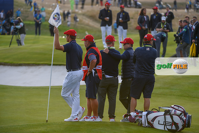 Bryson Dechambeau (Team USA) holds the pin on 18 as Alex Noran (Team Europe) drains a long birdie putt during Sunday's singles of the 2018 Ryder Cup, Le Golf National, Guyancourt, France. 9/30/2018.<br /> Picture: Golffile | Ken Murray<br /> <br /> <br /> All photo usage must carry mandatory copyright credit (© Golffile | Ken Murray)