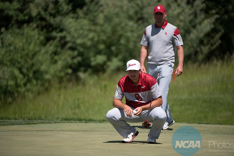SUGAR GROVE, IL - MAY 31: Blaine Hale and Head Coach Ryan Hybl of the University of Oklahoma line up a putt during the Division I Men's Golf Team Championship held at Rich Harvest Farms on May 31, 2017 in Sugar Grove, Illinois. Oklahoma won the team national title. (Photo by Jamie Schwaberow/NCAA Photos via Getty Images)