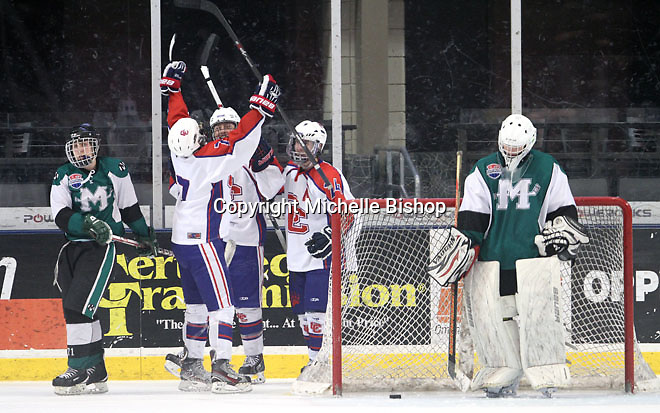 Ryan Worley (19), Dalton Walker (24) and Owen Berman (7) celebrate Cherry Creek's fifth goal. Cherry Creek (Colorado) beat Medina (Ohio) 5-1 on the third day of pool play during the 2014 High School Hockey National Championship in Omaha on March 28. (Photo by Michelle Bishop)