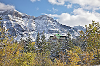 Prince of Whales Hotel at Waterton Lakes National Park, Vime Peak towers above the hotel and the Autumn landscape