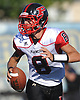 Mike Ciuffo #8, Plainedge quarterback, looks for an open receiver during a Nassau County Conference III varsity football game against host Lawrence High School on Saturday, Sept. 23, 2017. He threw for four touchdowns, including the game-winner with 23.3 seconds left in the fourth quarter, to lead Plainedge to a 38-34 win.