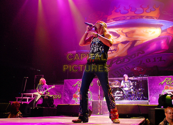 "CC DeVille, Bret Michaels and Rikki Rockett of Poison perform during ""Rock of Ages"" tour held at Copps Coliseum, Hamilton, Ontario, Canada.  .July 17th, 2012.on stage in concert live gig performance performing music full length black top jeans denim singing .CAP/ADM/BPC.©Brent Perniac/AdMedia/Capital Pictures."