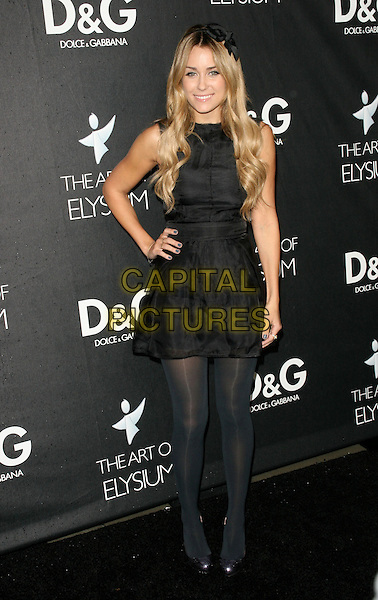 LAUREN CONRAD .the D&G celebration of the opening of the flagship boutique on Robertson Boulevardin in Beverly Hills, California, USA..December 15th, 2008.full length black dress tights hand on hip sleeveless  .CAP/DVS.©Debbie VanStory/Capital Pictures.