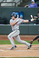 Brandon Miller (20) of the Potomac Nationals follows through on his swing against the Winston-Salem Dash at BB&T Ballpark on April 30, 2015 in Winston-Salem, North Carolina.  The Nationals defeated the Dash 5-4..  (Brian Westerholt/Four Seam Images)