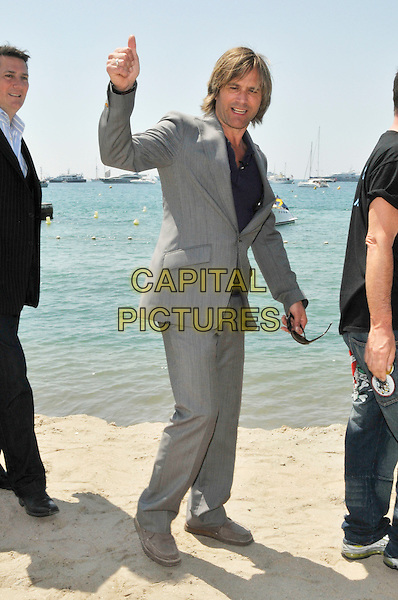 STEVE NORMAN of SPANDAU  BALLET.photocall .62nd International Cannes Film Festival.Cannes, France. 19th May 2009.full length grey gray suit hand thumb up gesture beach sand .CAP/PL.©Phil Loftus/Capital Pictures.