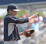 Masahiro Tanaka (Yankees),<br /> MARCH 31, 2015 - MLB :<br /> Pitcher Masahiro Tanaka of the New York Yankees gives a sign during a spring training baseball game against the Minnesota Twins at CenturyLink Sports Complex in Fort Myers, Florida, United States. (Photo by AFLO)