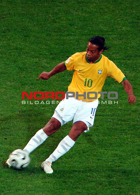FIFA WM 2006 -  Gruppe F Vorrunde ( Group AF)  <br /> Play   #43 (22-Jun) - Japan vs Brasilien  1 - 4<br /> <br /> Ronaldinho and the ball in<br />  the match.<br /> <br /> Foto &copy; nordphoto