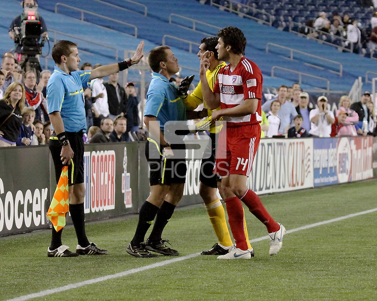 The referee, Jeff Gontarek steps in to prevent an altercation between FC Dallas goalkeeper Dario Sala (44) and FC Dallas defender George John (14) and the linesman after the Revolution goal.  This incident earned the goalkeeper a yellow card. The New England Revolution drew FC Dallas 1-1, at Gillette Stadium on May 1, 2010