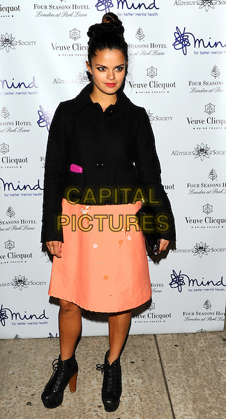 Bip Ling.'Mindful' gala exhibition and gala dinner to raise funds for the Mind creative therapies fund, Imperial War Museum, London, England..September 21st, 2011.full length black jacket shoes peach orange skirt clutch bag.CAP/CJ.©Chris Joseph/Capital Pictures.