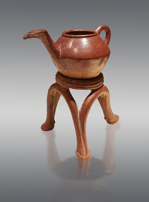 Terra cotta Hittite beaker shaped side spouted teapot and three legged stand - 1700 BC to 1500BC - Kültepe Kanesh - Museum of Anatolian Civilisations, Ankara, Turkey. Against a grey  background
